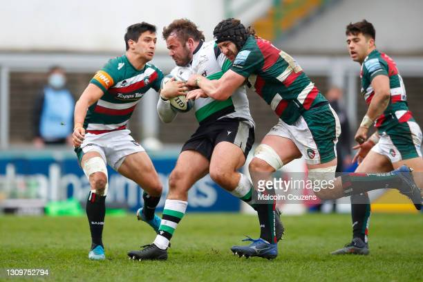 George McGuigan of Newcastle Falcons is tackled by Matias Moroni and Harry Wells of Leicester Tigers during the Gallagher Premiership Rugby match...