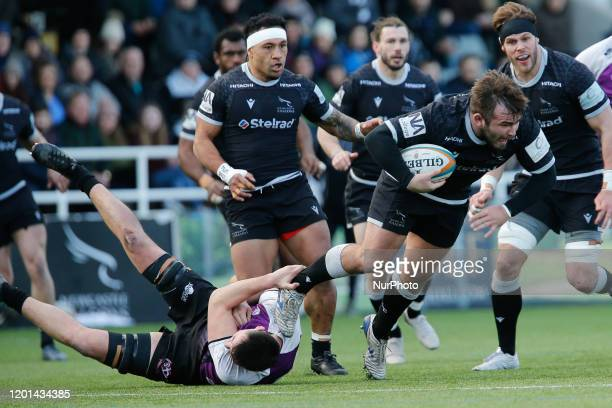 George McGuigan of Newcastle Falcons tries to break a tackle during the Greene King IPA Championship match between Newcastle Falcons and Cornish...
