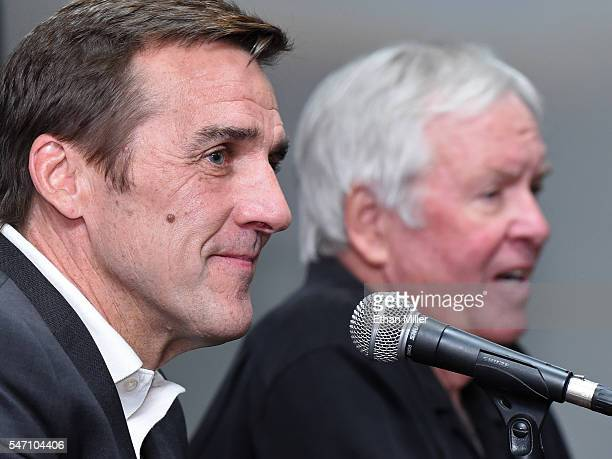 George McPhee listens as majority owner of the Las Vegas NHL franchise Bill Foley speaks after announcing McPhee as the team's general manager during...