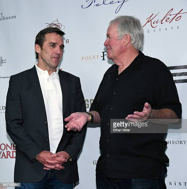 George McPhee talks with majority owner of the Las Vegas NHL franchise Bill Foley after he announced McPhee as the team's general manager during a...