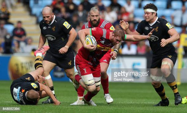 George Merrick of Harlequins charges upfield during the Aviva Premiership match between Wasps and Harlequins at The Ricoh Arena on September 17 2017...