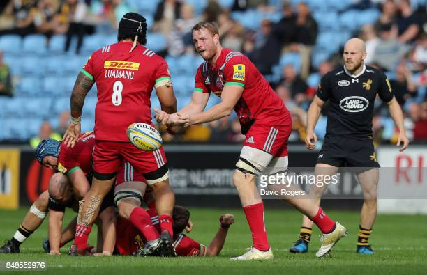 George Merrick of Harlequins passes the ball during the Aviva Premiership match between Wasps and Harlequins at The Ricoh Arena on September 17 2017...