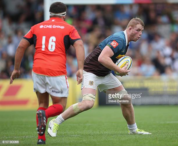George Merrick of Harlequins runs with the ball during the Aviva Premiership match between Harlequins and Saracens at Twickenham Stoop on September...