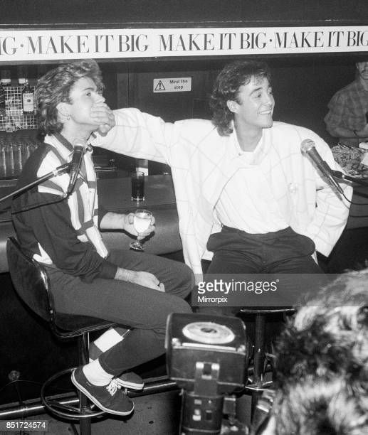 George Michael and Andrew Ridgeley better known as the pop duo Wham Seen here giving a press conference during a cocktail party 2nd November 1984