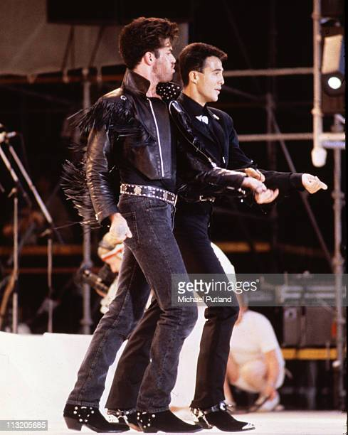 George Michael and Andrew Ridgeley of pop duo Wham performing at their farewell concert entitled 'The Final' at Wembley Stadium London 28th June 1986