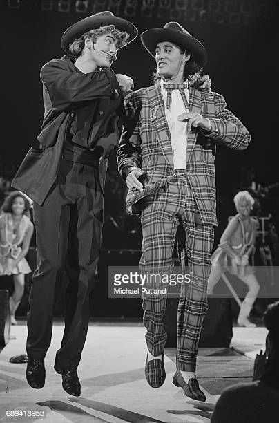 George Michael and Andrew Ridgeley of Wham performing during the pop duo's 1985 world tour January 1985 In the background are backing singers Pepsi...