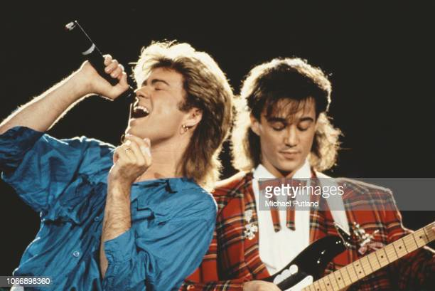 George Michael and Andrew Ridgeley of Wham! performing together live on stage during the pop duo's 1985 world tour, January 1985. 'The Big Tour' took...