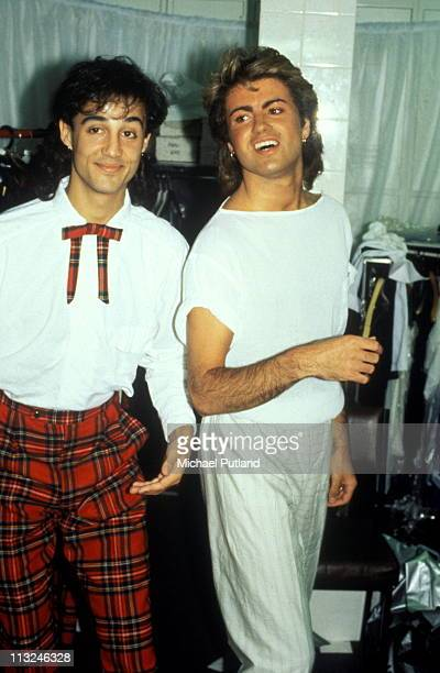 George Michael and Andrew Ridgeley of Wham portrait backstage 1985
