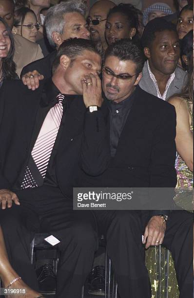 George Michael and boyfriend Kenny Goss in the audience for a Versace show at the Theatre National de Chaillot at the Trocadero in ParisFrance on the...