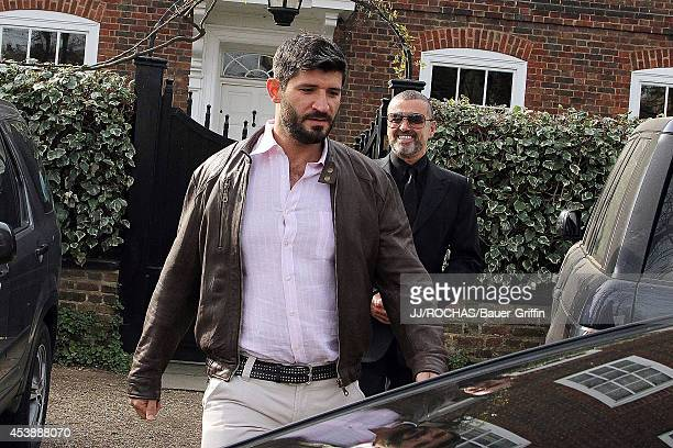 George Michael and Fadi Fawaz are seen on March 14 2012 in London United Kingdom