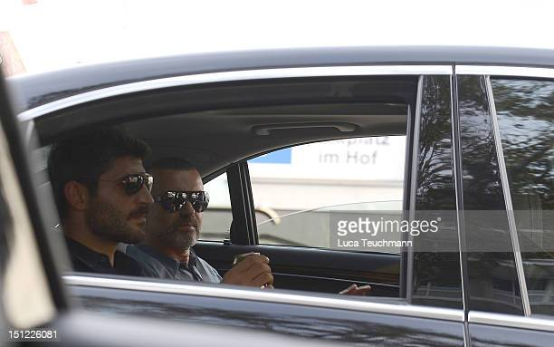 George Michael and Fadi Fawaz arrive at Airport Vienna on September 4 2012 in Vienna Austria