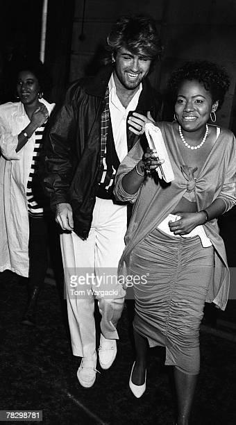 George Michael and girlfriend Pat Hernandez at Langan's Brasserie on circa 1985 in London, England.