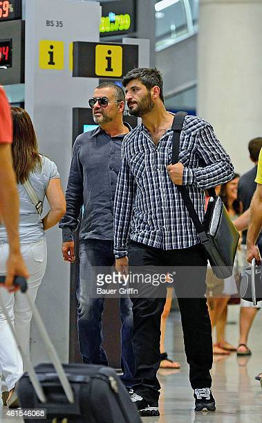 George Michael and his boyfriend Fadi Fawaz are seen at Barcelona El Prat Airport on July 29 2012 in Barcelona Spain