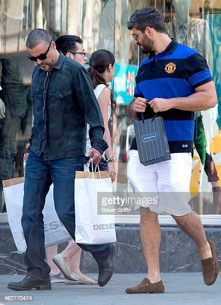 George Michael and his boyfriend Fadi Fawaz are seen on July 31 2012 in Barcelona Spain