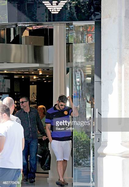 George Michael and his boyfriend Fadi Fawaz are seen shopping on July 31 2012 in Barcelona Spain