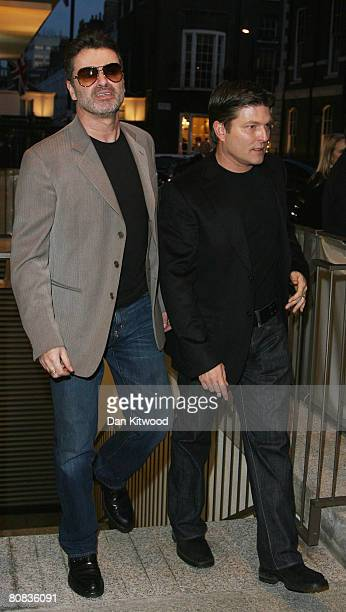 George Michael and Kenny Goss arrive to a private view of Linda McCartney photographs at the James Hymen Gallery on April 23 2008 in London England