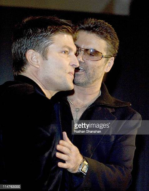 George Michael and partner Kenny Goss during Versace Hosts a Private Party for George Michael A Different Story'' December 15 2005 at Cafe Les Deux...