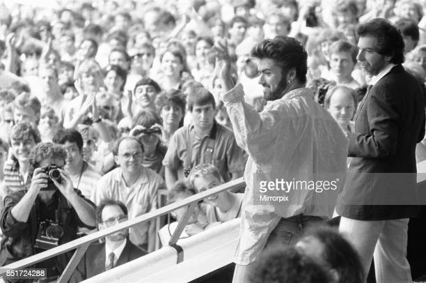 George Michael in the audience during the opening of the Live Aid Concert at Wembley Stadium 13th July 1985