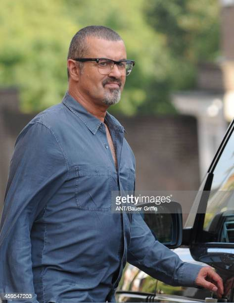 George Michael leaves the Cote Brassiere restaurant in Highgate on August 25 2013 in London United Kingdom