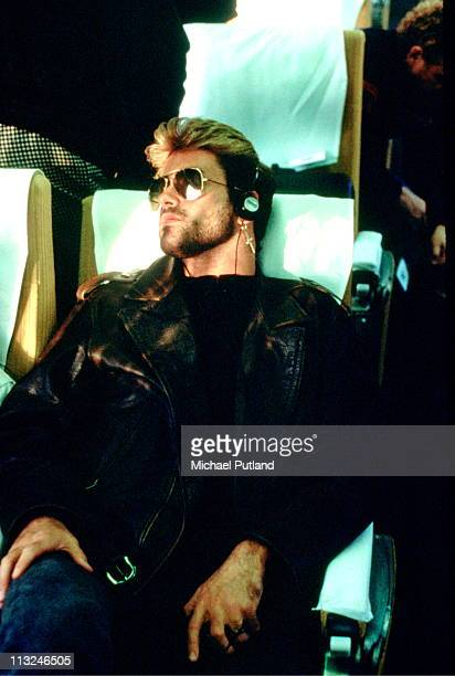 George Michael on a train listening to a Walkman Japan March 1988