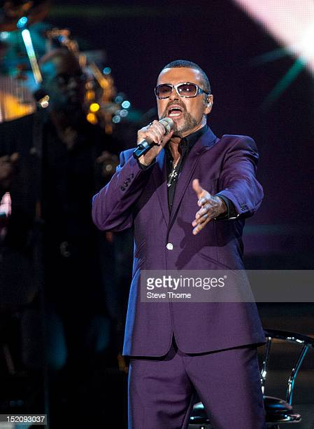 George Michael performs on stage at LG Arena on September 16, 2012 in Birmingham, United Kingdom.