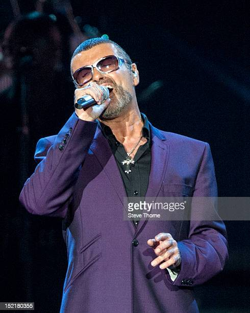 George Michael performs on stage at LG Arena on September 16 2012 in Birmingham United Kingdom