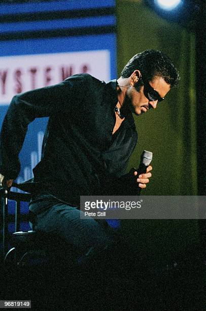 George Michael performs on stage at 'NetAID' in Wembley Stadium on October 9th 1999 in London United Kingdom