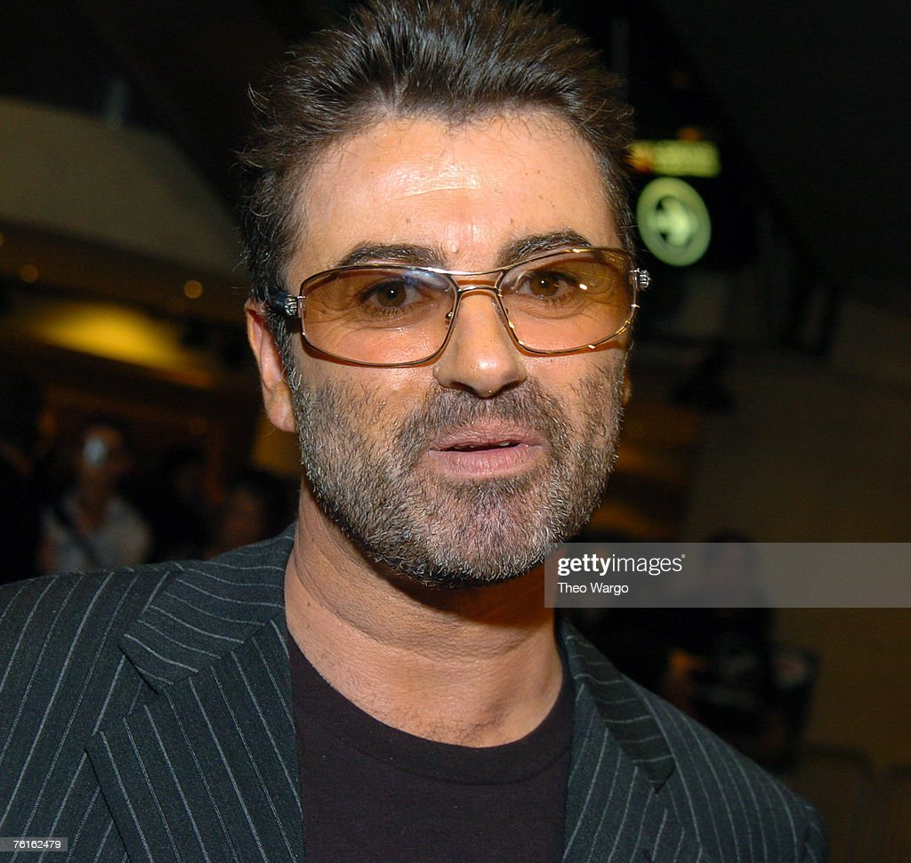 """George Michael Signs Copies of his new CD """"Patience"""""""