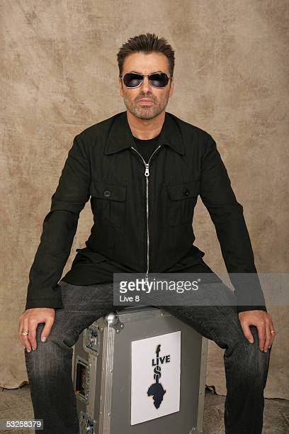 George Michael poses for a studio portrait backstage at 'Live 8 London' in Hyde Park on July 2 2005 in London England The free concert is one of ten...