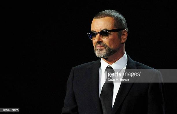 George Michael presents during the BRIT Awards 2012 held at the O2 Arena on February 21 2012 in London England