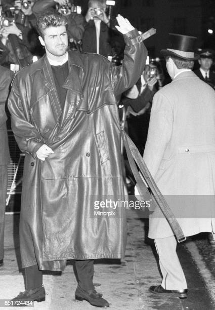 George Michael waves to fans outside the Savoy Hotel where the launch party for his first solo album Faith was taking place 31st October 1987