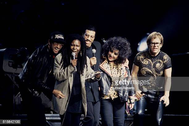 George Michael Whoopi Goldberg Lionel Richie Liz Taylor and Elton John performing at a benefit concert for the Elizabeth Taylor AIDS Foundation at...