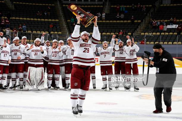 George Mika of the Massachusetts Minutemen skates with the National Championship Trophy after defeating the St. Cloud State Huskies 5-0 during the...