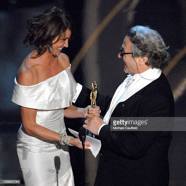 George Miller accepts Best Animated Feature Film award for 'Happy Feet' from presenter Cameron Diaz