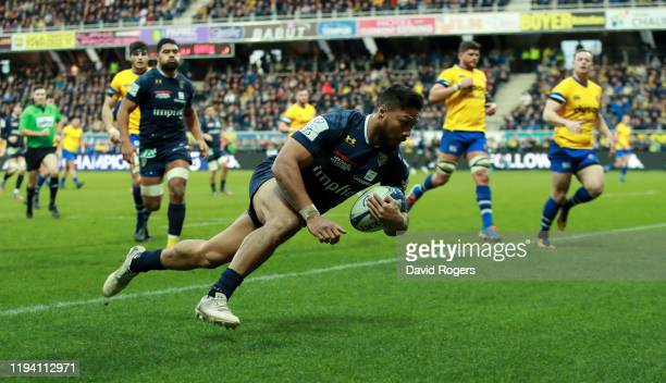 George Moala of Clermont Auvergne dives over for their fourth try during the Heineken Champions Cup Round 4 match between ASM Clermont Auvergne and...