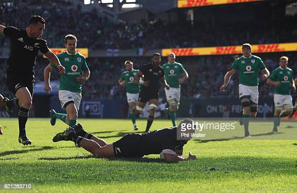 George Moala of New Zealand dives over to score the opening try during the international match between Ireland and New Zealand at Soldier Field on...