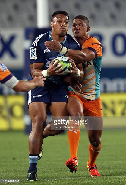 George Moala of the Blues is tackled by Cornal Hendricks of the Cheetahs during the round six Super Rugby match between the Blues and the Cheetahs at...