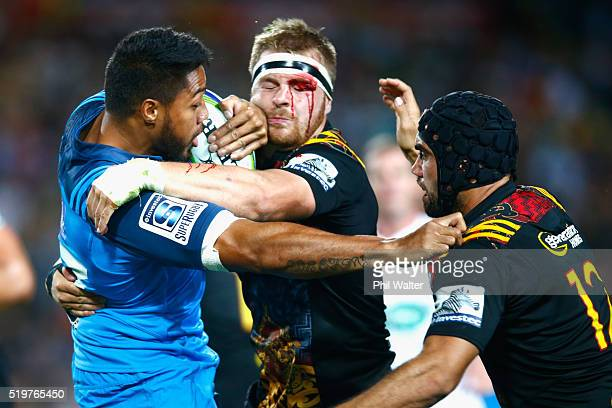 George Moala of the Blues is tackled by Sam Cane of the Chiefs during the round seven Super Rugby match between the Chiefs and the Blues on April 8...