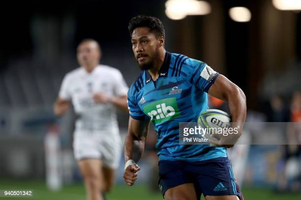 George Moala of the Blues makes a break during the round sevens Super Rugby match between the Blues and the Sharks at Eden park on March 31 2018 in...