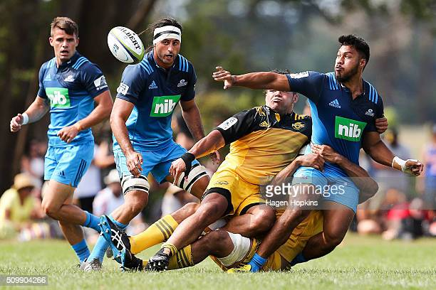 George Moala of the Blues offloads during the Super Rugby preseason match between the Blues and the Hurricanes at Eketahuna Rugby Club on February 13...