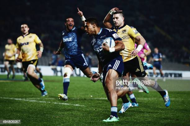 George Moala of the Blues scores a try during the round 16 Super Rugby match between the Blues and the Hurricanes at Eden Park on May 31 2014 in...