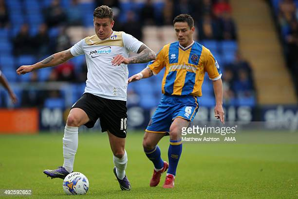 George Moncur of Colchester United and Ian Black of Shrewsbury Town during the Sky Bet League One match between Shrewsbury Town and Colchester United...