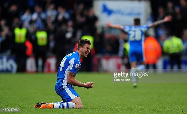 George Moncur of Colchester United celebrates on the final whistle as his side avoid relegation during the Sky Bet League One match between...