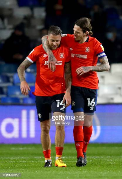 George Moncur of Luton Town celebrates after scoring their sides first goal with Glen Rea of Luton Town during the Sky Bet Championship match between...