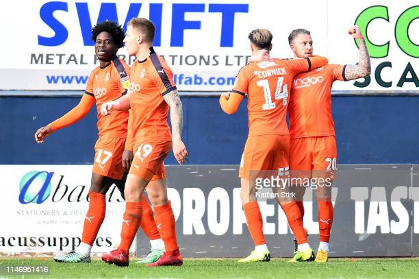 George Moncur of Luton Town celebrates scoring his sides third goal during the Sky Bet League One match between Luton Town and Oxford United at...