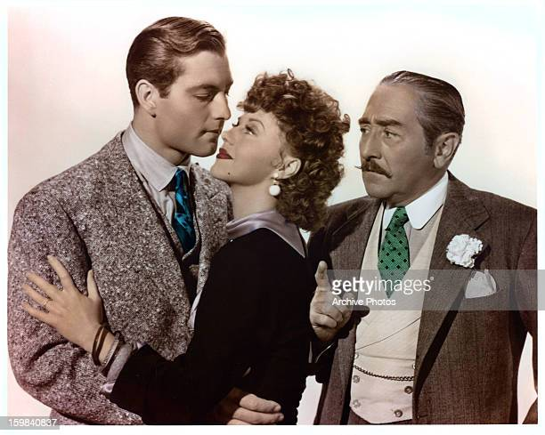 George Montgomery holds Ginger Rogers while Adolphe Menjou looks on in publicity portrait for the film 'Roxie Hart', 1942.