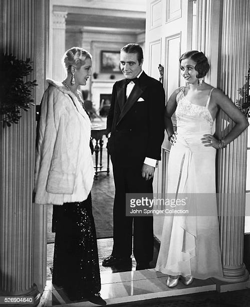 George Morris and Helen Morris bid farewell to Joan Whitley in a scene from the 1930 comedy Divorce Among Friends