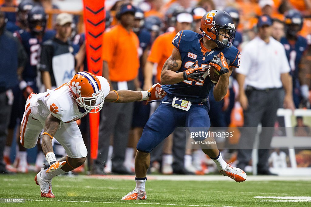 George Morris II #27 of Syracuse Orange spins past Garry Peters #26 of Clemson Tigers during a short reception gain in the fourth quarter on October 5, 2013 at the Carrier Dome in Syracuse, New York. Clemson defeated Syracuse 49-14.