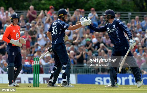 George Munsey of Scotland and team mate Callum MacLeod reach a 100 partnership during the One Day International match between Scotland and England at...