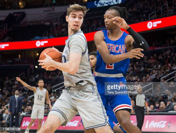 George Muresan of Georgetown pulls the ball away from Stacy Beckton JR #2 of American during a game between American University and Georgetown...